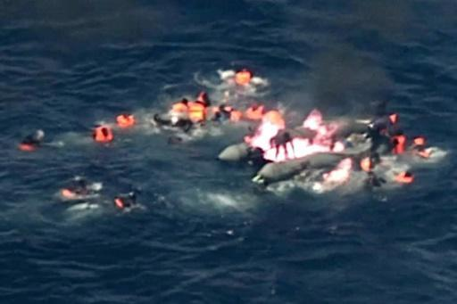 Dramatic video shows migrants rescued from burning boat