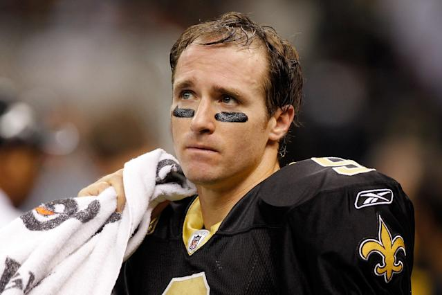 NEW ORLEANS, LA - DECEMBER 26: Quarterback Drew Brees #9 of the New Orleans Saints looks on against the Atlanta Falcons in the second quarter at the Mercedes-Benz Superdome on December 26, 2011 in New Orleans, Louisiana. (Photo by Chris Graythen/Getty Images)