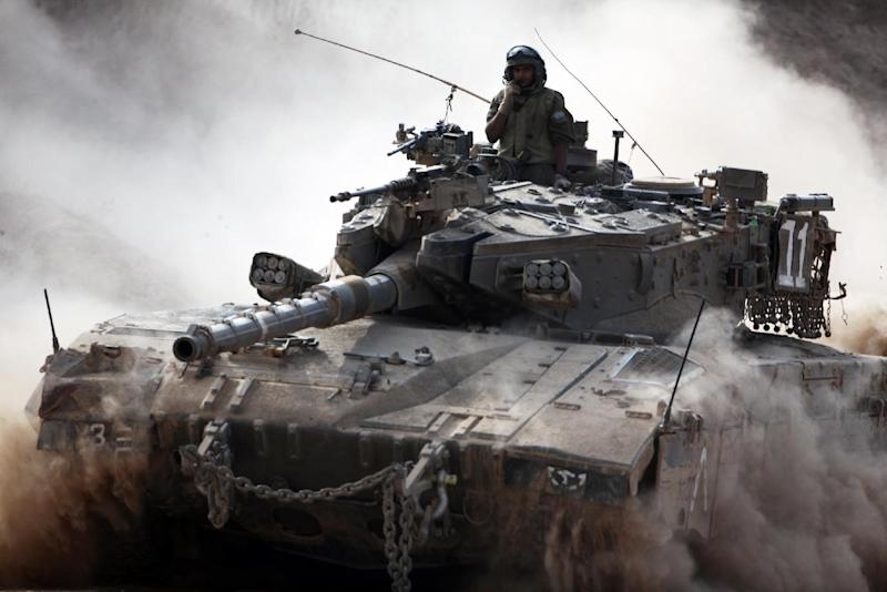 An Israeli army Merkava tank rolls along the border between Israel and the Hamas-controlled Gaza Strip on July 28, 2014