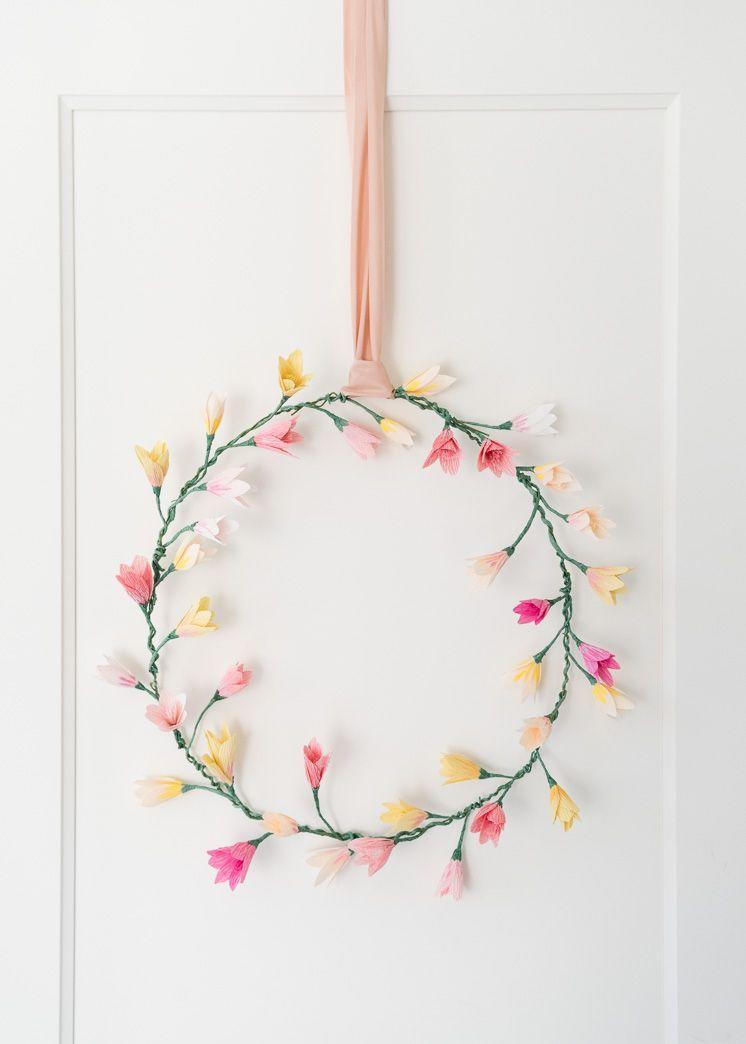 """<p>Showcasing crêpe paper flowers in delicate, spring-like hues, this wreath is certainly a beautiful way to bring springtime into your home. </p><p><strong>Get the tutorial at <a href=""""https://thehousethatlarsbuilt.com/2018/01/pink-paper-blossom-wreath.html/"""" rel=""""nofollow noopener"""" target=""""_blank"""" data-ylk=""""slk:The House That Lars Built"""" class=""""link rapid-noclick-resp"""">The House That Lars Built</a>.</strong></p><p><a class=""""link rapid-noclick-resp"""" href=""""https://go.redirectingat.com?id=74968X1596630&url=https%3A%2F%2Fwww.walmart.com%2Fip%2FCousin-DIY-Copper-20g-Jewelry-and-Beading-Wire-8-yd-Green%2F33069221&sref=https%3A%2F%2Fwww.thepioneerwoman.com%2Fhome-lifestyle%2Fcrafts-diy%2Fg35698457%2Fdiy-easter-wreath-ideas%2F"""" rel=""""nofollow noopener"""" target=""""_blank"""" data-ylk=""""slk:SHOP CRAFT WIRE"""">SHOP CRAFT WIRE</a></p>"""