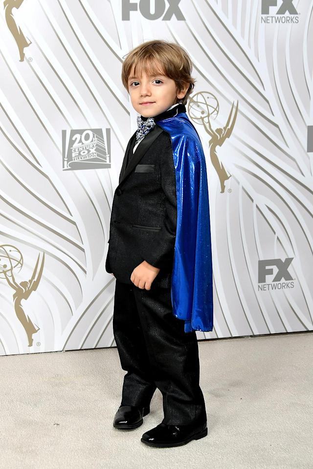 <p><em>Modern Family</em> cutie Jeremy Maguire, in his scene-stealing cape, attended the Fox Broadcasting Co., Twentieth Century Fox Television, FX, and <em>National Geographic</em> bash. (Photo: Neilson Barnard/Getty Images) </p>