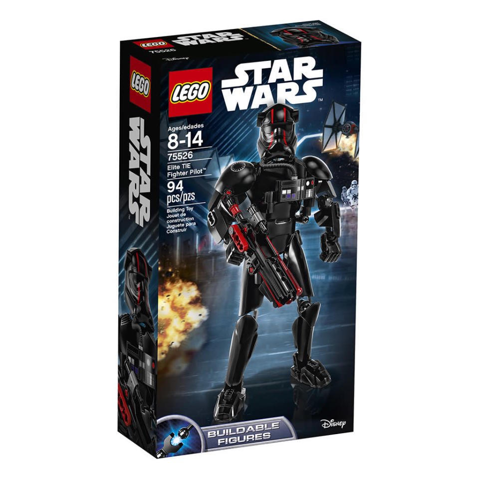 """<p>""""Buckle up and get ready for action with the Elite TIE Fighter Pilot! Build this intimidating figure with red-striped helmet and breathing system and then put him in a battle pose. Arm his spring-loaded blaster rifle and you're ready to take on the Resistance!"""" $19.99 (Photo: Lego) </p>"""