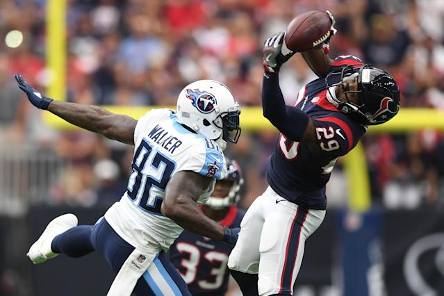 <p>Houston Texans free safety Andre Hal (29) intercepts a pass intended for Tennessee Titans tight end Delanie Walker (82) during the first quarter at NRG Stadium. Mandatory Credit: Shanna Lockwood-USA TODAY Sports </p>