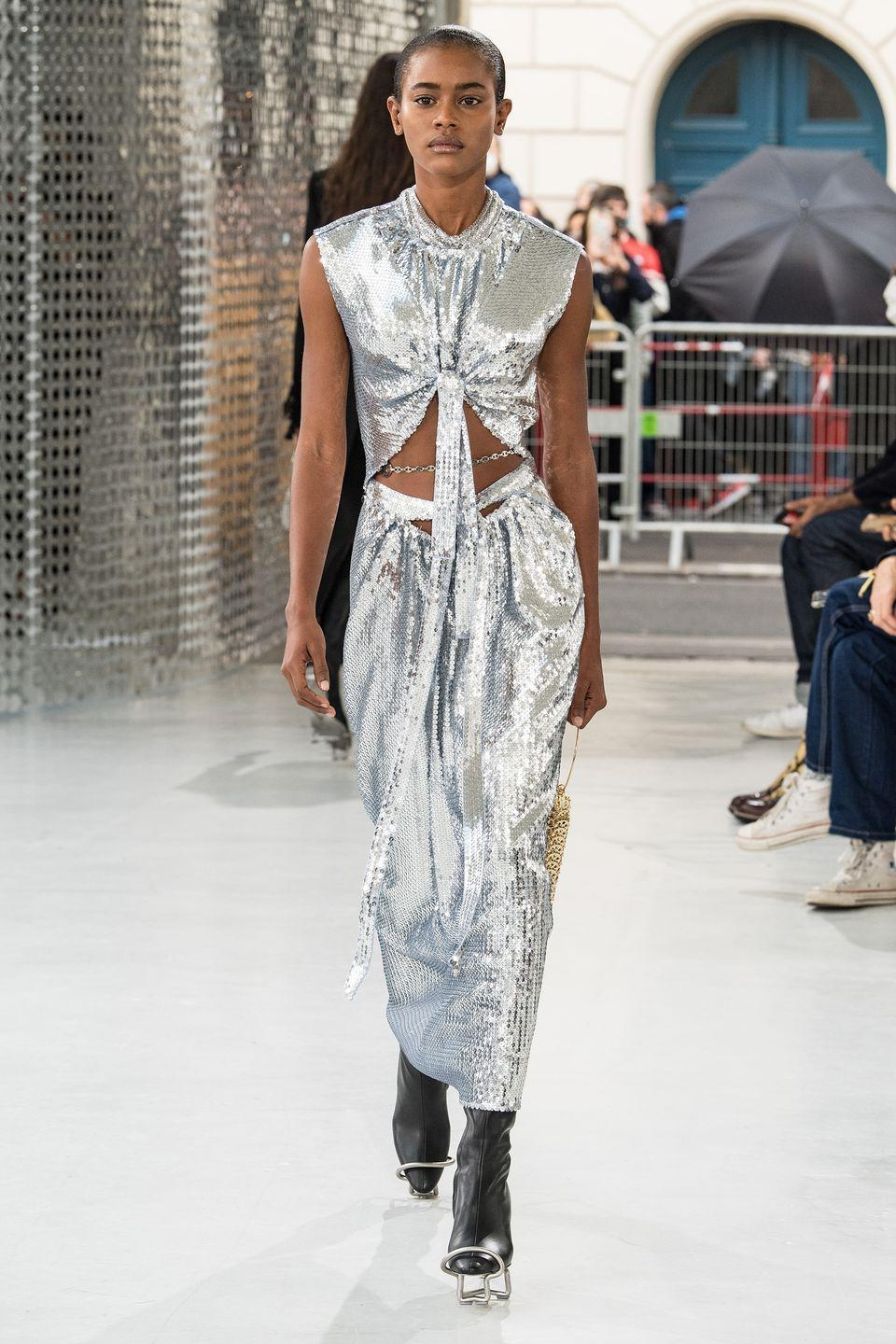 "<p>Julien Dossena's spring 2021 collection began with a simple question, ""What if an everyday wardrobe could be reimagined with an avant-garde attitude?"" The designer tasked himself with taking Rabanne's futuristic codes, its chain mail, and history of ""unwearable materials,"" and making them somehow more casual and, well, wearable. The question was answered in those chain-mail dresses being reworked in long shapes that seem to flow, in denim, floral motifs, leopard prints, trench coats, lingerie and baby-doll dresses—Rabanne's version of lounge-chic. Asked and answered. —<em>Kerry Pieri</em></p>"