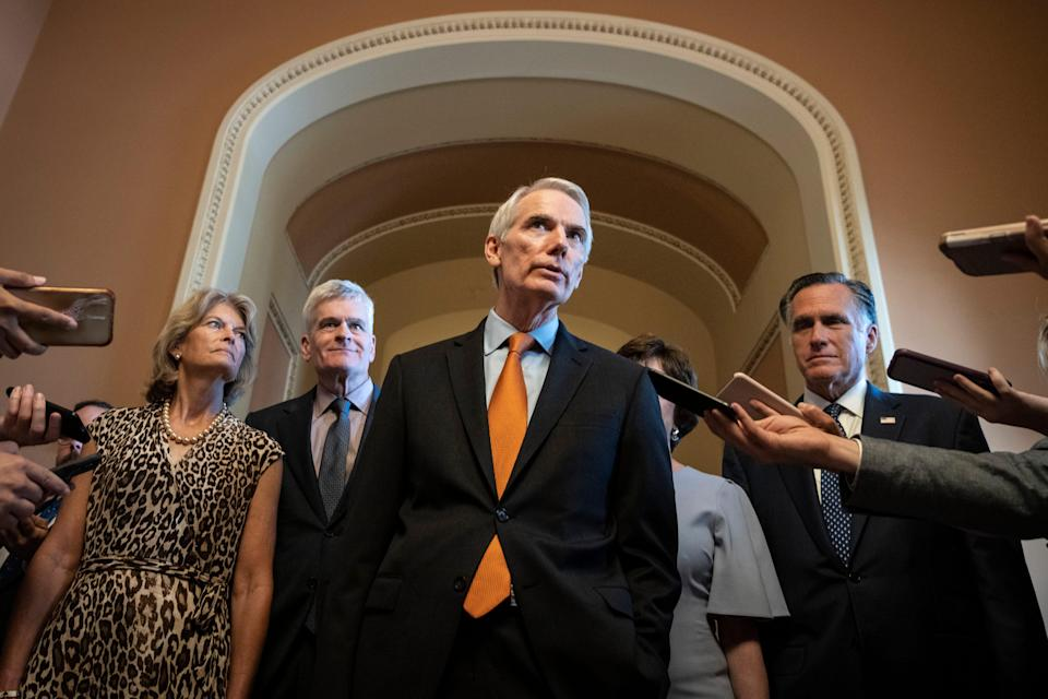 The lead GOP negotiators on the bipartisan infrastructure legislation, Sens. Lisa Murkowski, Bill Cassidy, Rob Portman, Susan Collins and Mitt Romney, speak to reporters Wednesday after meeting privately with Senate Minority Leader Mitch McConnell.