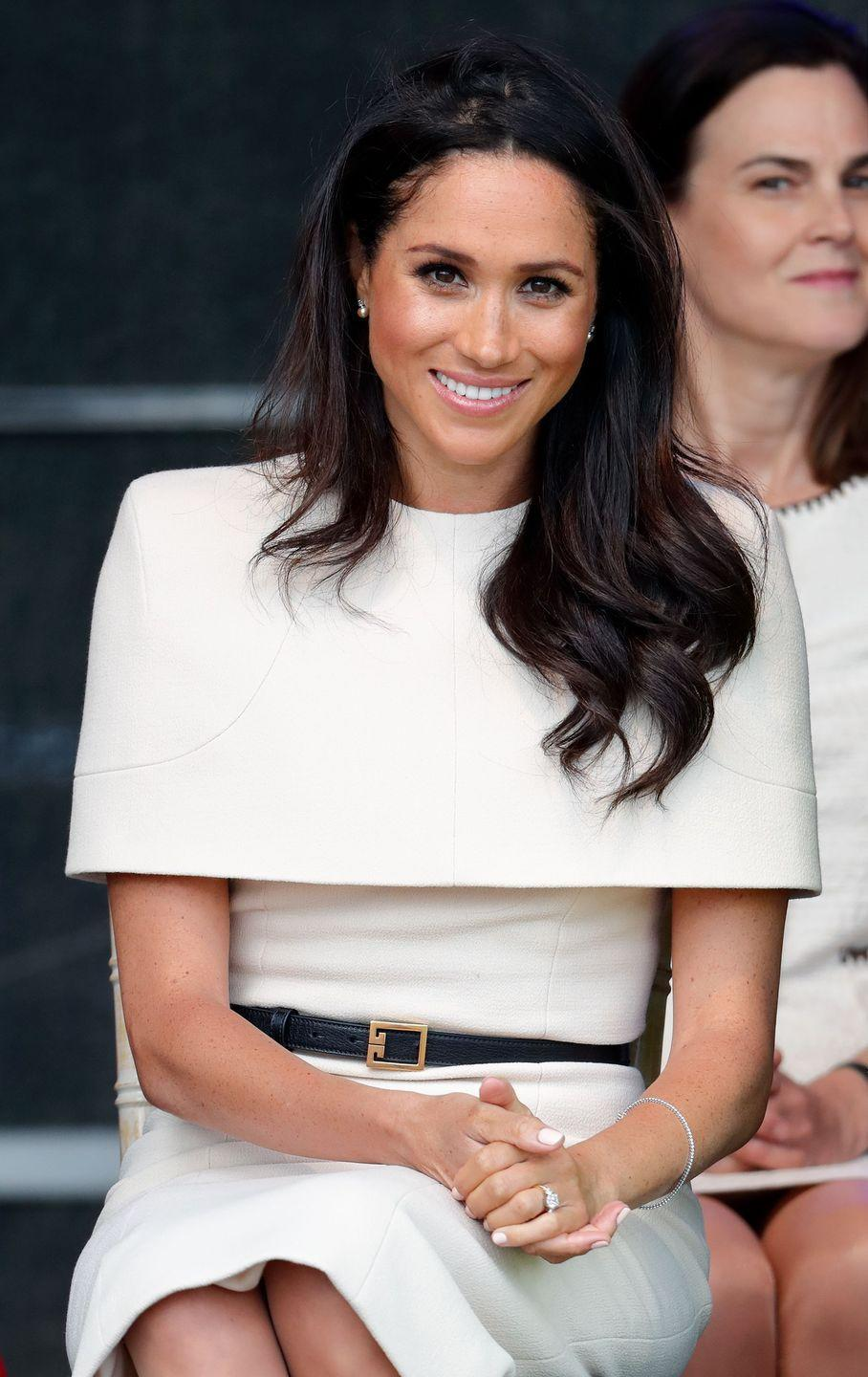 <p>Markle lets her hair down in signature loose curls a few days after her wedding.</p>