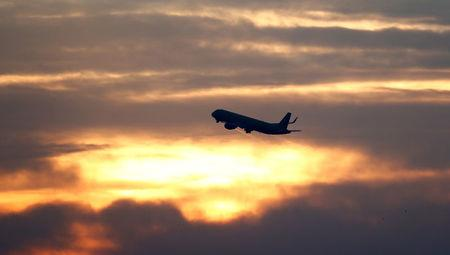 FILE PHOTO: A plane is seen during sunrise at the international airport in Munich, Germany, January 9, 2018.    REUTERS/Michaela Rehle