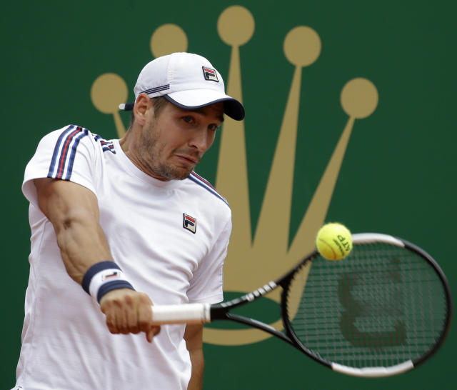 Serbia's Dusan Lajovic returns a ball to Italy's Fabio Fognini during the men's singles final match of the Monte Carlo Tennis Masters tournament in Monaco, Sunday, April, 21, 2019. (AP Photo/Claude Paris)