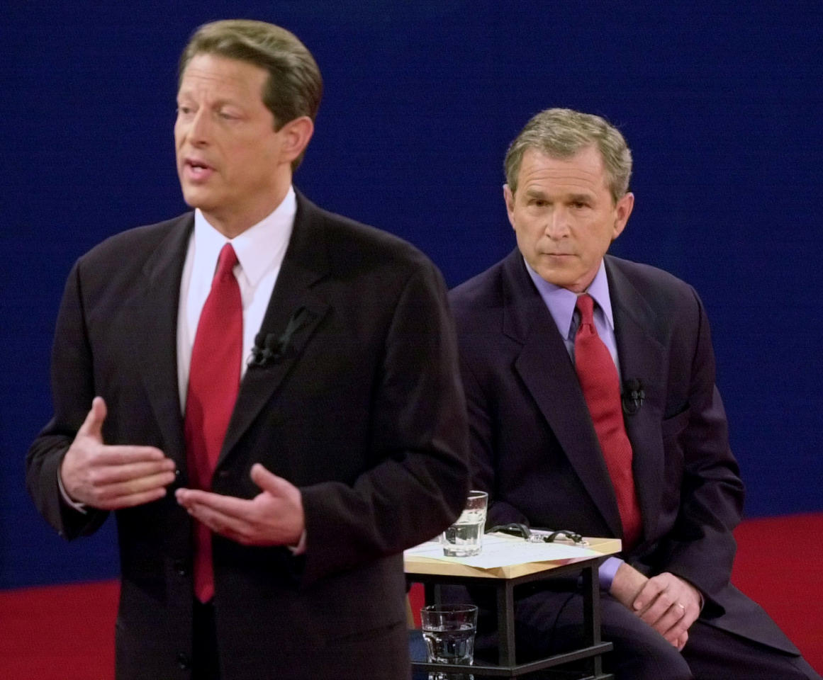 FILE - In this Oct. 17, 2000 file photo, Democratic presidential candidate Vice President Al Gore, left, speaks as Republican presidential candidate Texas Gov. George W. Bush watches during their debate at Washington University in St. Louis. Body language speaks volumes in televised debates. Classic moments from debates past often had more to do with what the candidates did _ or didn't do _ than what they said. (AP Photo/Ed Reinke, File)