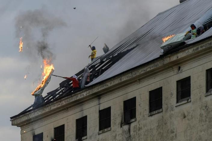 Inmates burn a mattress at Villa Devoto prison in Buenos Aires on April 24 during a riot demanding measures to prevent the spread of the coronavirus (AFP Photo/Juan Mabromata)