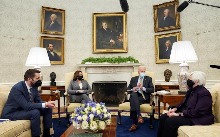 U.S. President Joe Biden is flanked by Vice President Kamala Harris and Treasury Secretary Janet Yellen during the weekly economic briefing as Brian Deese, director of the National Economic Council, listens in the Oval Office at the White House in Washington, U.S., April 9, 2021. REUTERS/Kevin Lamarque