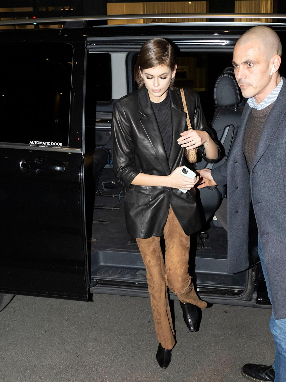 """Aside from the long leather coat, the <a href=""""https://www.teenvogue.com/story/kaia-gerber-leather-blazer?mbid=synd_yahoo_rss"""" rel=""""nofollow noopener"""" target=""""_blank"""" data-ylk=""""slk:leather blazer"""" class=""""link rapid-noclick-resp"""">leather blazer</a> is also a staple in Kaia's wardrobe."""