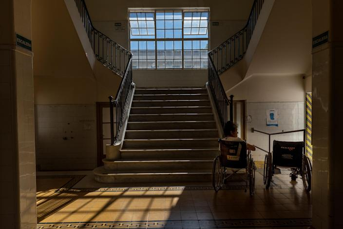 """A patient gets some fresh air in the hallway of Koch Pavilion, a hospital unit that is exclusively used by tuberculosis patients at the Muniz public hospital, in Buenos Aires, Argentina, Feb. 5, 2019. Patricia Figueroa, a social worker at the Muniz public hospital, said the facility was struggling with overcrowding as it faced a growing number of TB patients, which she described as """"a record in recent history."""" (Photo: Magali Druscovich/Reuters)"""