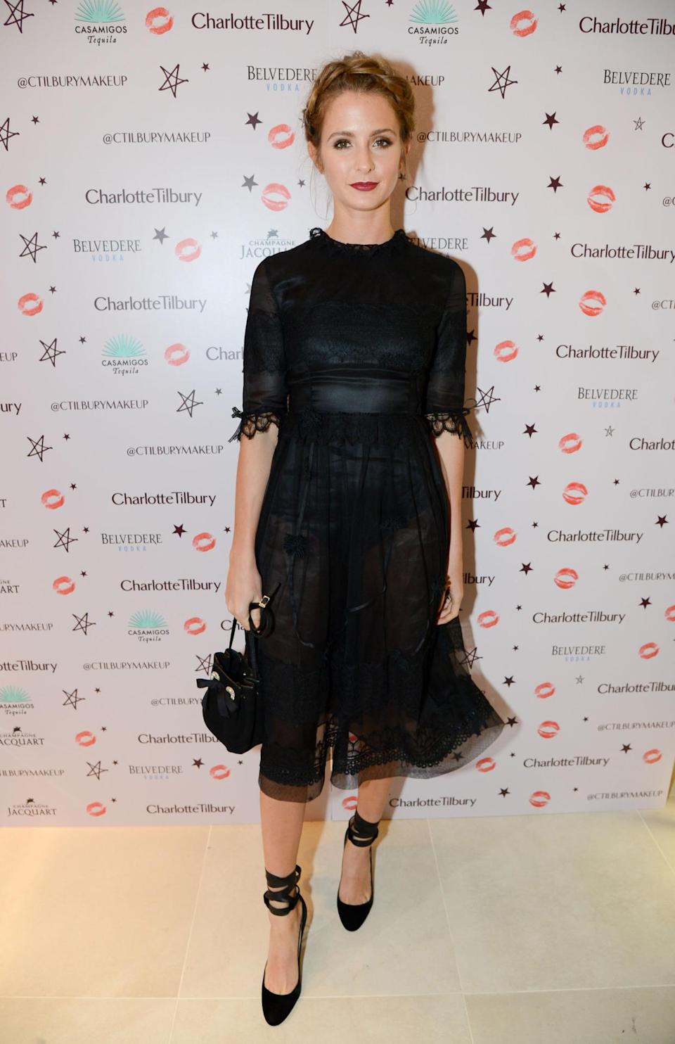 Millie Mackintosh flaunted her sartorial prowess in a chic Shiatzy Chen dress, featuring a sheer skirt that showed off the black satin bodysuit she was wearing underneath. She paired the look with Jimmy Choo heels and an L.K. Bennett bag. [Photo: Rex]