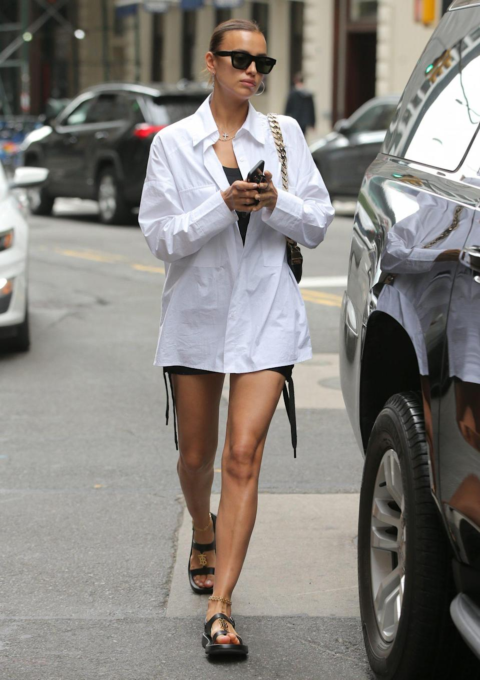 <p>Irina Shayk leaves an office building in N.Y.C. wearing an oversized top, shorts and sandals on June 22. </p>