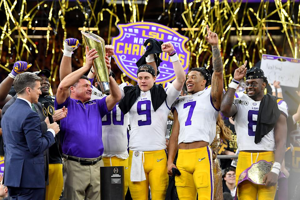 NEW ORLEANS, LOUISIANA - JANUARY 13: Head coach Ed Orgeron of the LSU Tigers raises the National Championship Trophy with Joe Burrow #9, Grant Delpit #7, and Patrick Queen #8 after the College Football Playoff National Championship game at the Mercedes Benz Superdome on January 13, 2020 in New Orleans, Louisiana. The LSU Tigers topped the Clemson Tigers, 42-25. (Photo by Alika Jenner/Getty Images)