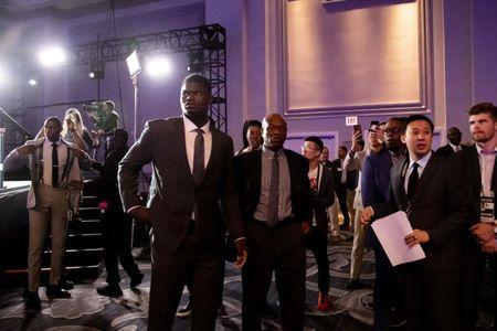 FILE PHOTO: May 14, 2019; Chicago, IL, USA; NBA top prospect Zion Williamson (middle left) is seen during the 2019 NBA Draft Lottery at the Hilton Chicago. Mandatory Credit: Patrick Gorski-USA TODAY Sports