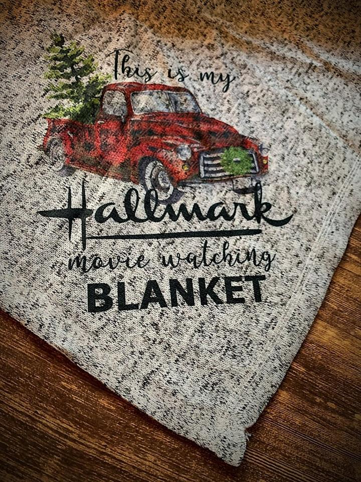 """<p>Hallmark movies will be even more heartwarming with a cozy <a href=""""https://www.popsugar.com/buy/Hallmark-Watching-Throw-518219?p_name=Hallmark%20Watching%20Throw&retailer=etsy.com&pid=518219&price=24&evar1=buzz%3Aus&evar9=45555300&evar98=https%3A%2F%2Fwww.popsugar.com%2Fentertainment%2Fphoto-gallery%2F45555300%2Fimage%2F45555303%2FHallmark-Watching-Throw&prop13=mobile&pdata=1"""" rel=""""nofollow"""" data-shoppable-link=""""1"""" target=""""_blank"""" class=""""ga-track"""" data-ga-category=""""Related"""" data-ga-label=""""https://www.etsy.com/listing/735336472/hallmark-watching-throwpersonalized?ga_order=most_relevant&amp;ga_search_type=all&amp;ga_view_type=gallery&amp;ga_search_query=&amp;ref=sc_gallery-1-1&amp;plkey=2c208396de4312ea835135f2b1d3ebe53083634a%3A735336472&amp;pro=1"""" data-ga-action=""""In-Line Links"""">Hallmark Watching Throw</a> ($24). </p>"""