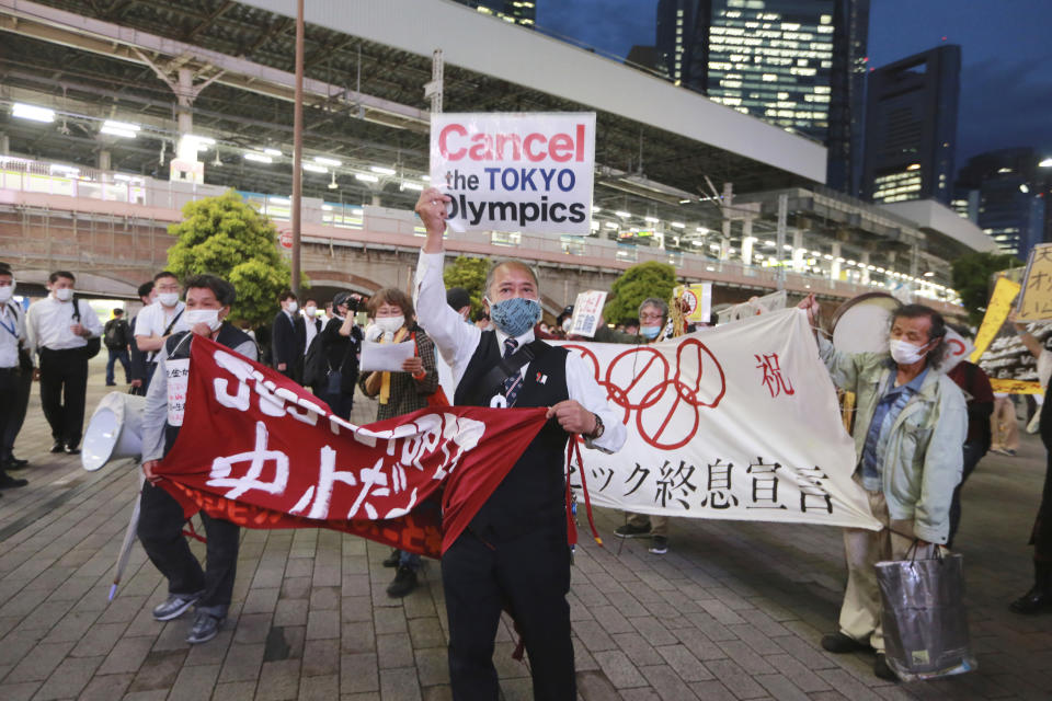 FILE - In this May 17, 2021, file photo, demonstrators protest against the Tokyo 2020 Olympics in Tokyo. The IOC and Tokyo Olympic organizers start three days of virtual meetings Wednesday, May 19, 2021 and will run into some of the strongest medical-community opposition so far with the games set to open in just over eight weeks. (AP Photo/Koji Sasahara, File)