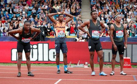 Athletics - Diamond League - Birmingham Grand Prix - Alexander Stadium, Birmingham, Britain - August 18, 2018 Christian Coleman, Noah Lyles and Michael Rodgers of the U.S. with Jamaica's Tyquendo Tracey as they wait for the results on the big screen after the men's 100m Action Images via Reuters/Peter Cziborra