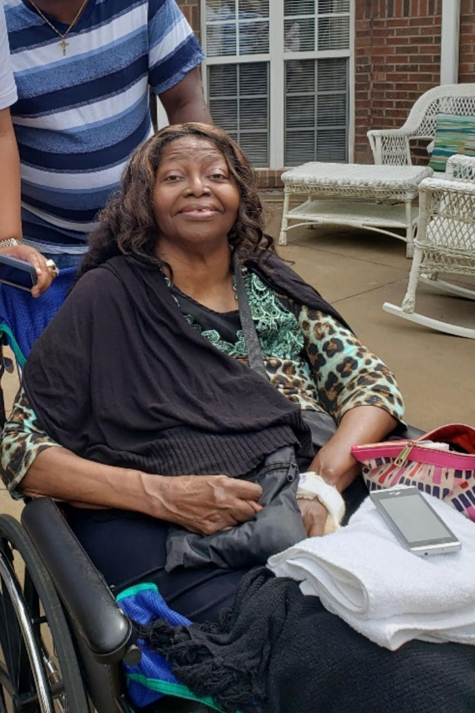 This photo provided by Tamika Dalton shows her mother, Theresa Dalton. When COVID-19 kept visitors from going inside the Blumenthal Nursing and Rehabilitation Center in Greensboro, N.C, Tamika would often visit at her mother's window a couple times a day. Through the glass, Dalton didn't like what she saw: Fewer and fewer aides passed by, and her mother sometimes sat for hours in a soiled diaper. (Courtesy Tamika Dalton via AP)