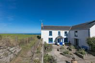"""<p>A former National Trust property that has been lovingly restored, this white and blue picture-book cottage sits a less than half an hour's walk (or four minute's drive) from both Land's End and Sennen Cove beach.</p><p>Though obviously perfect for the surf-lovers out there, due to the owner's expertly curated recommendations list of pubs, theatres and museums, foodies, culture-lovers and walkers will all be in heaven at Carnacalla Cottage.</p><p>Not that all of the magic is a drive away - the cottage itself is home to roll-top baths (in a bedroom, no less), a cosy snug (complete with wood burning stove and smart TV) and two gardens ideal for long lunches and games, meaning you may never actually leave the property. </p><p><strong>Cottage for 12 from £400 per night (seven night minimum)</strong></p><p><a class=""""link rapid-noclick-resp"""" href=""""https://www.airbnb.co.uk/rooms/27888603"""" rel=""""nofollow noopener"""" target=""""_blank"""" data-ylk=""""slk:BOOK ONLINE"""">BOOK ONLINE</a></p>"""