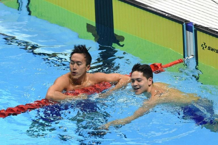 Singapore's Joseph Schooling (R) will be looking to finish his disappointing competition on a high (AFP Photo/TED ALJIBE)