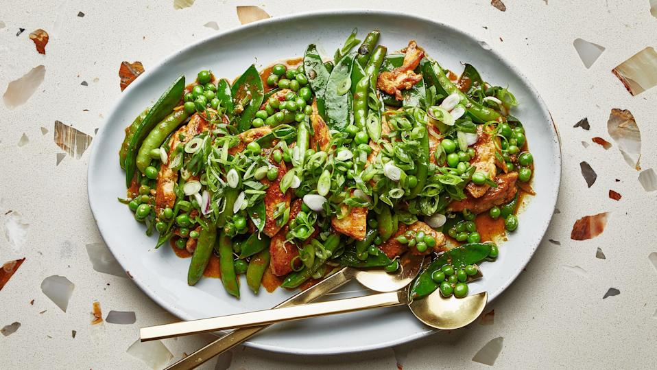 "The fastest homemade curry paste and handfuls of charred beans and peas transform skinless, boneless chicken breasts into a quick, highly craveable dinner. <a href=""https://www.bonappetit.com/recipe/chicken-and-beans-stir-fry?mbid=synd_yahoo_rss"" rel=""nofollow noopener"" target=""_blank"" data-ylk=""slk:See recipe."" class=""link rapid-noclick-resp"">See recipe.</a>"