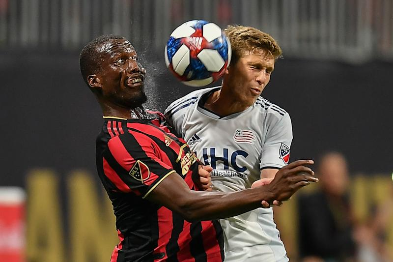 ATLANTA, GA OCTOBER 19: Atlanta's Florentin Pogba (4) and New England's Scott Caldwell (6) fight for a header during the MLS playoff match between the New England Revolution and Atlanta United FC on October 19th, 2019 at Mercedes-Benz Stadium in Atlanta, GA. (Photo by Rich von Biberstein/Icon Sportswire via Getty Images)