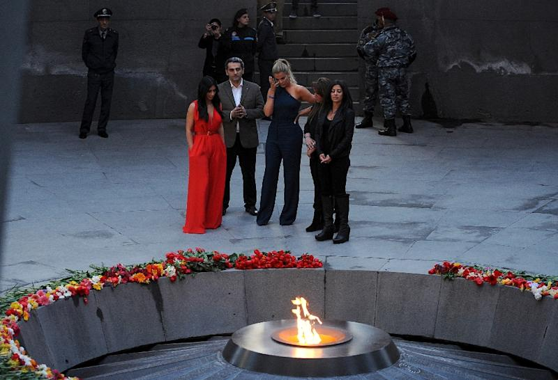 US reality TV star Kim Kardashian (L) and her sister Khloe (3rdL) visit the genocide memorial, which commemorates the 1915 mass killing of Armenians in the Ottoman Empire, in Yerevan on April 10, 2015 (AFP Photo/Karen Minasyan)