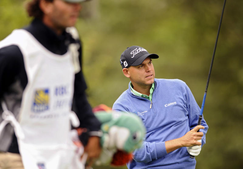 Bill Haas watches his drive down the third fairway during the third round of the RBC Heritage golf tournament in Hilton Head Island, S.C., Saturday, April 20, 2013. (AP Photo/Stephen Morton)