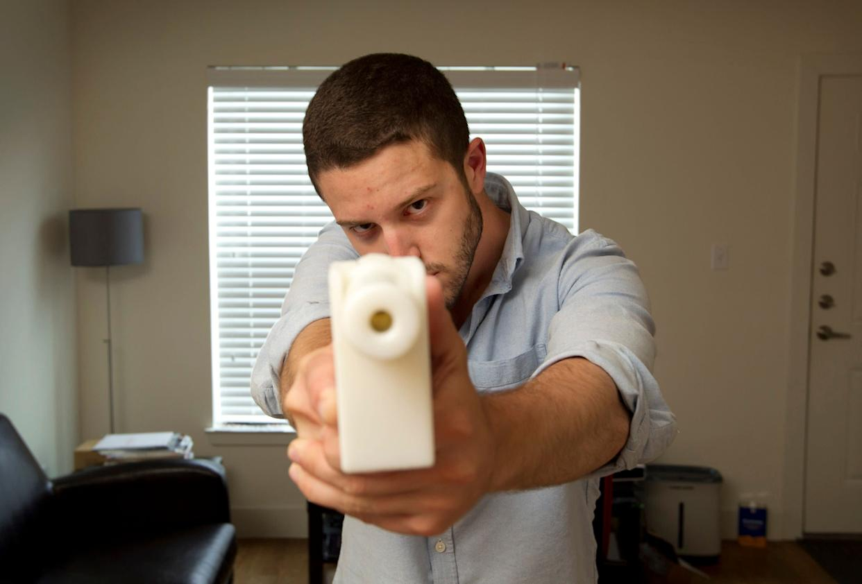 Cody Wilson shows off his first 3D-printed handgun, The Liberator, at his home in Austin, Texas, on May 10, 2013. (Photo: SIPA USA/PA Images)