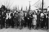 <p>American civil rights campaigner Martin Luther King (1929 - 1968) and his wife Coretta Scott King lead a Black voting rights march from Selma, Alabama, to the state capital in Montgomery. </p>