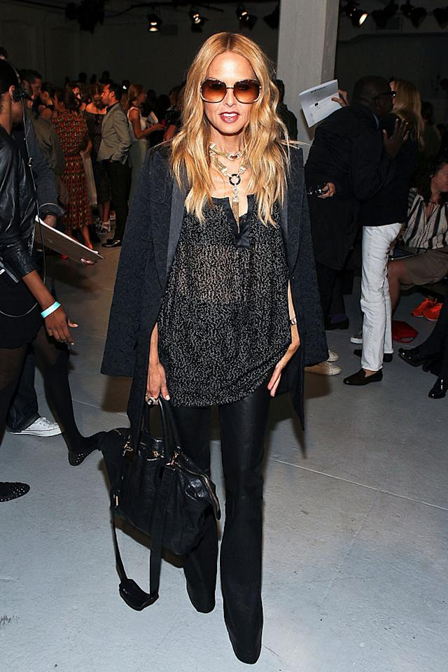 Celebrity stylist Rachel Zoe donned head-to-toe black and her gigantic signature sunglasses to the Rodarte show. (9/11/12)