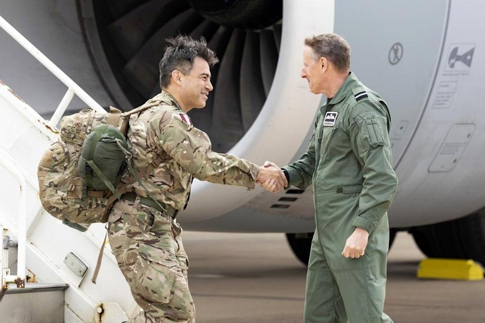 Commander of 16 Air Assault Brigade Brigadier James Martin (left), being greeted by Air Mobility Force Commander Air Commodore David Manning at RAF Brize Norton, Oxfordshire. on his return from Afghanistan (SAC Samantha Holden RAF/Ministry of Defence/Crown Copyright/PA) (PA Media)