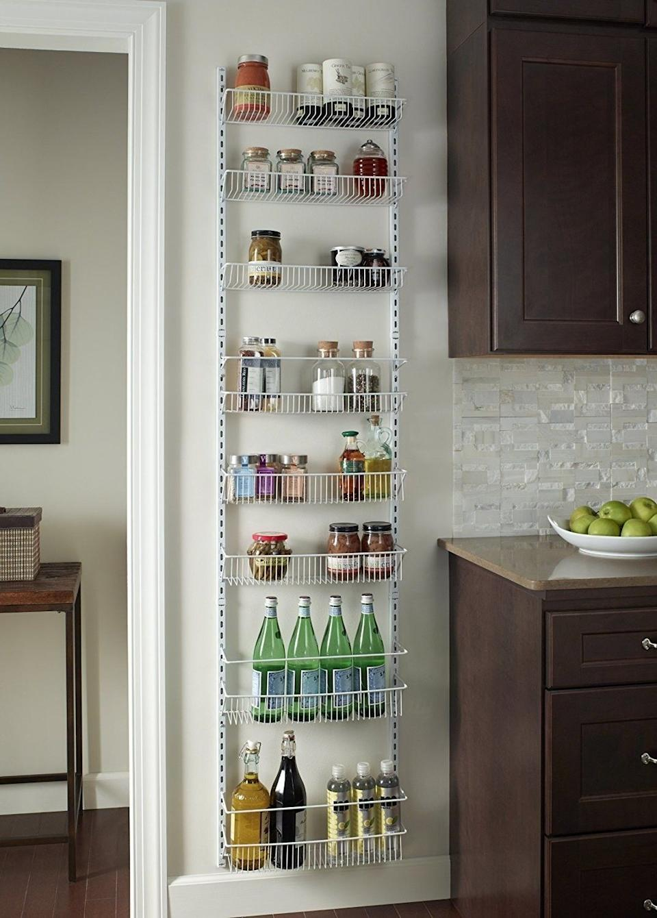 """No need to """"rack""""<i></i>your brain over how to store food without a pantry. This turns a wall into a place to store all your cans and jars.<br /><br /><strong>Promising review:</strong>""""This thing is freaking awesome!<strong>It is so sturdy and can hold some really heavy stuff!</strong>I used the door hooks to hang it on the back of a door. A single person can assemble and mount this easily. I didn't end up using all of the shelves since some of the items I need to store are large and heavy — I liked having the option of leaving them out and just using as many as I needed. This is a great product and I will buy it again for other closets and storage areas."""" —<a href=""""https://amzn.to/3uYx5PV"""" target=""""_blank"""" rel=""""nofollow noopener noreferrer"""" data-skimlinks-tracking=""""5902331"""" data-vars-affiliate=""""Amazon"""" data-vars-href=""""https://www.amazon.com/gp/profile/amzn1.account.AHSXW3KBYITABSL3T6GPB56EV3RQ?tag=bfmal-20&ascsubtag=5902331%2C32%2C37%2Cmobile_web%2C0%2C0%2C16540662"""" data-vars-keywords=""""cleaning"""" data-vars-link-id=""""16540662"""" data-vars-price="""""""" data-vars-product-id=""""16013316"""" data-vars-retailers=""""Amazon"""">Chimera</a><br /><br /><strong>Get it from Amazon for<a href=""""https://amzn.to/2RDYfx3"""" target=""""_blank"""" rel=""""nofollow noopener noreferrer"""" data-skimlinks-tracking=""""5902331"""" data-vars-affiliate=""""Amazon"""" data-vars-asin=""""B00D8OYUTM"""" data-vars-href=""""https://www.amazon.com/dp/B00D8OYUTM?tag=bfmal-20&ascsubtag=5902331%2C32%2C37%2Cmobile_web%2C0%2C0%2C16540681"""" data-vars-keywords=""""cleaning"""" data-vars-link-id=""""16540681"""" data-vars-price="""""""" data-vars-product-id=""""17912801"""" data-vars-product-img=""""https://m.media-amazon.com/images/I/31bg5sduOSL.jpg"""" data-vars-product-title=""""ClosetMaid 1233 Adjustable 8-Tier Wall and Door Rack, 77-Inch Height X 18-Inch Wide,white"""" data-vars-retailers=""""Amazon"""">$33.99</a>.</strong>"""