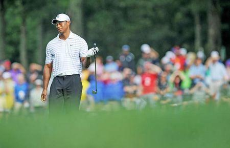 Aug 8, 2014; Louisville, KY, USA; PGA golfer Tiger Woods reacts during the second round of the 2014 PGA Championship golf tournament at Valhalla Golf Club. Thomas J. Russo-USA TODAY Sports
