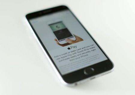 An Apple iphone 6 with Apple Pay is shown in this photo illustration in  Encinitas , California