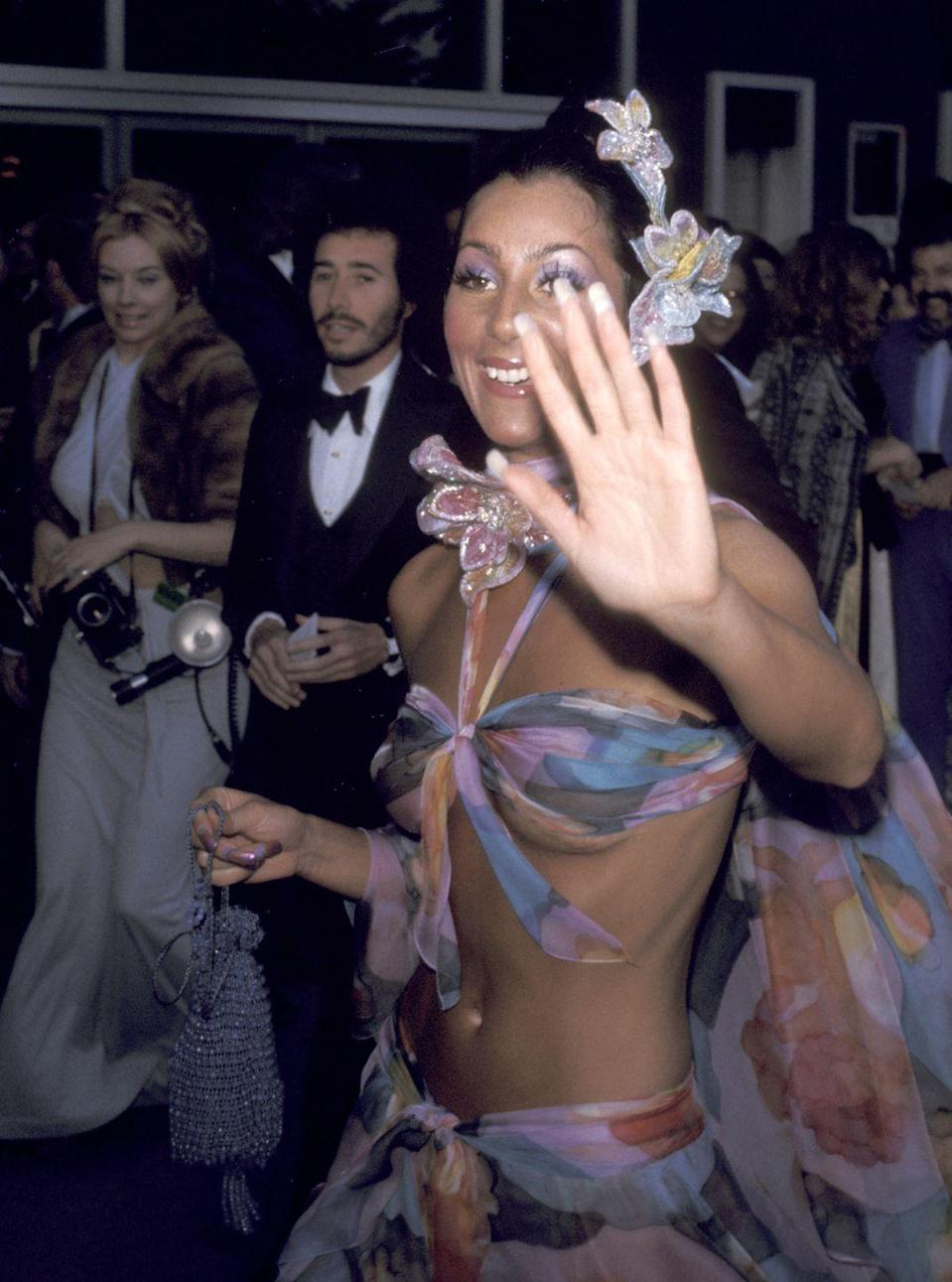 <p>In a sheer floral-printed bra top and skirt and matching accessories at the Oscars. </p>