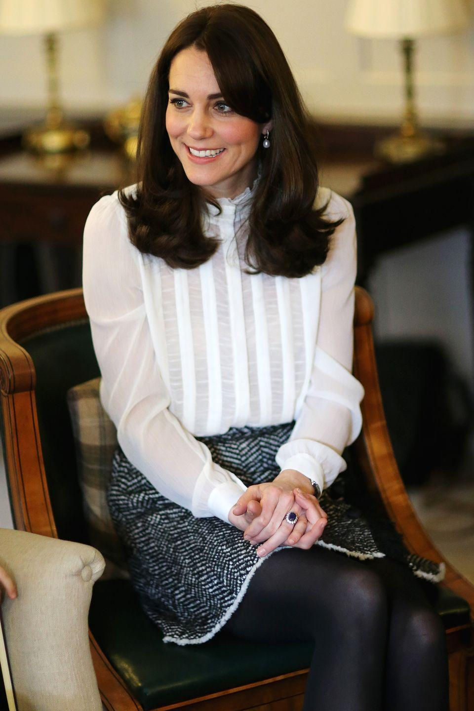 <p>The Duchess knows the power of a black + white ensemble, pairing her high collar blouse with a tweed skirt for a polished look as Guest Editor of The Huffington Post. </p>