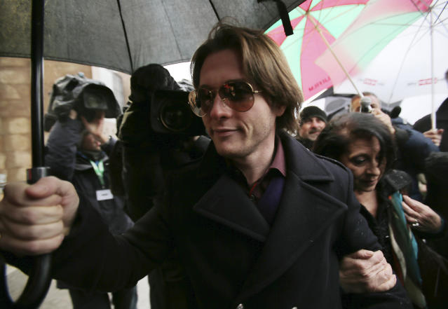 Raffaele Sollecito arrives to attend the final hearing before the third court verdict for the murder of British student Meredith Kercher, in Florence, Italy, Thursday, Jan. 30, 2014. The first two trials produced flip-flop verdicts of guilty then innocent for Kercher former roommate, American student Amanda Knox, who is not attending the hearing, and her former Italian boyfriend, Raffaele Sollecito, and the case has produced harshly clashing versions of events. A Florence appeals panel designated by Italy's supreme court to address issues it raised about the acquittal is set to deliberate Thursday, with a verdict expected later in the day. (AP Photo/Antonio Calanni)