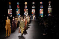 Models wear creations during Dior's Spring-Summer 2021 fashion collection presented Tuesday, Sept. 29, 2020 during the Paris fashion week. (AP Photo/Francois Mori)
