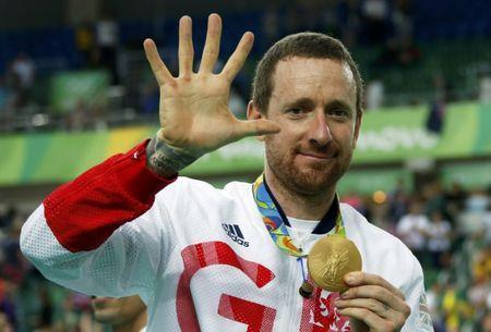 2016 Rio Olympics - Cycling Track - Victory Ceremony - Men's Team Pursuit Victory Ceremony - Rio Olympic Velodrome - Rio de Janeiro, Brazil - 12/08/2016. Bradley Wiggins (GBR) of Britain poses with his gold medal. REUTERS/Eric Gaillard