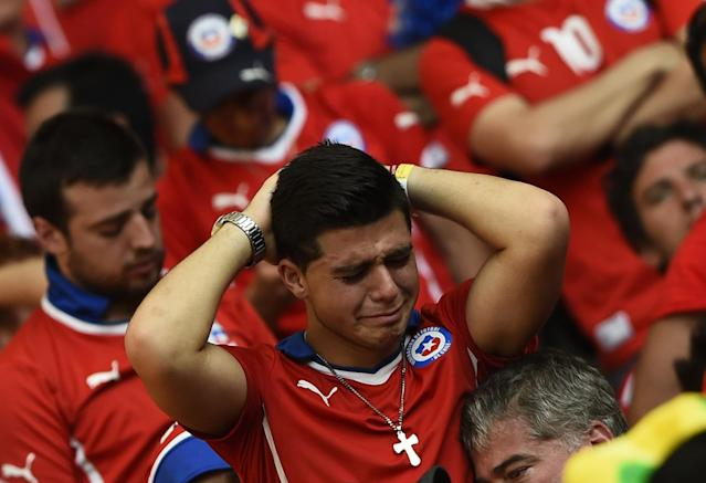 A Chile's fan reacts after losing their 2014 World Cup round of 16 game against Brazil at the Mineirao stadium in Belo Horizonte June 28, 2014. REUTERS/Dylan Martinez (BRAZIL - Tags: SOCCER SPORT WORLD CUP TPX IMAGES OF THE DAY)