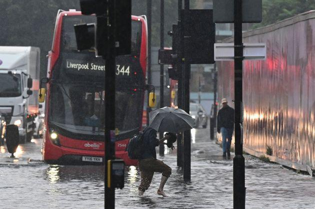 London saw some of the worst flooding, with public transport heavily affected (Photo: JUSTIN TALLIS via Getty Images)