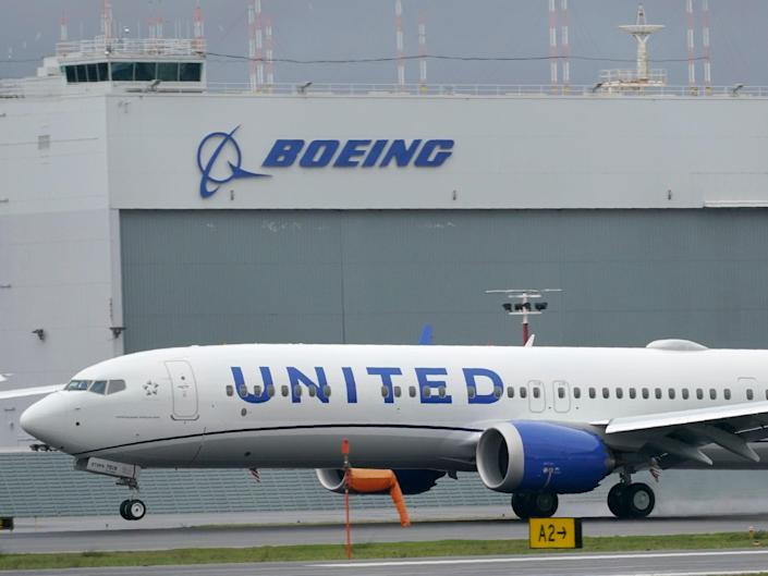 A Boeing 737 Max 9 built for United Airlines landing at King County International Airport (AP)
