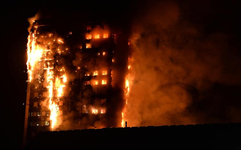 Flames engulf the block - Credit: GIULIO THUBURN/AFP