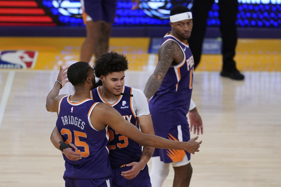 Phoenix Suns forward Mikal Bridges (25) and forward Cameron Johnson (23) celebrate after winning 113-100 over the Los Angeles Lakers of Game 6 of an NBA basketball first-round playoff series Thursday, June 3, 2021, in Los Angeles. The Suns won the series 4-2 and will move on to round 2. (AP Photo/Ashley Landis)