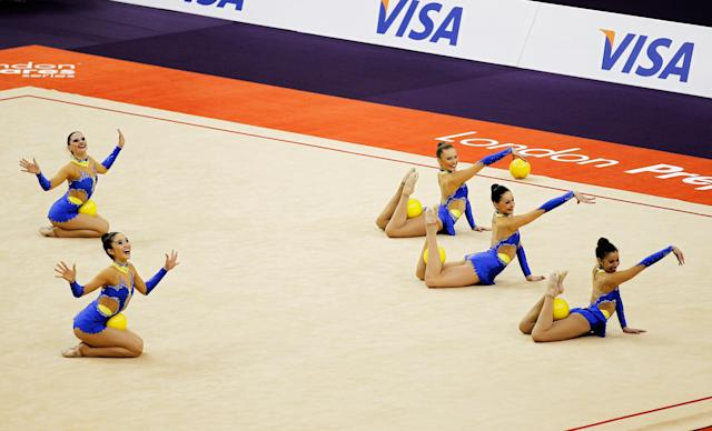 LONDON, ENGLAND - JANUARY 18: The Great Britain team in action in the Group All-Around during the FIG Rhythmic Gymnastics Olympic Qualification round at North Greenwich Arena on January 18, 2012 in London, England. (Photo by Paul Gilham/Getty Images)