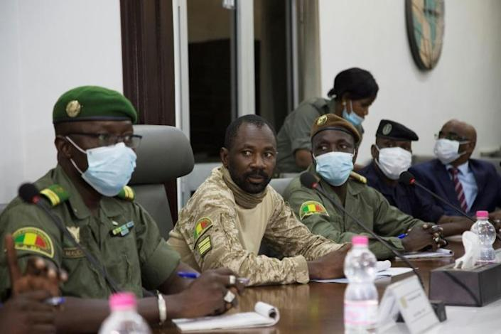 Colonel Assimi Goita (C) has led two coups in a year in jihadist-plagued Mali